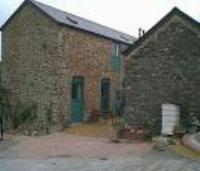 Barn and stables converted to four cottages and set in two acres of land near Totnes
