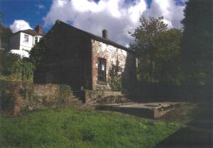 A coach house with planning permission for conversion in Port Talbot, Wales