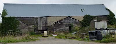 A timber barn frame barn for sale