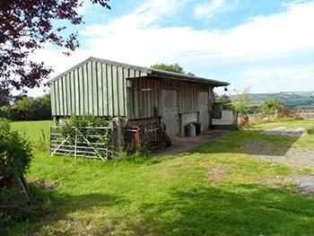 Equestrian property comprising an unconverted barn, stables and land near Exmoor, Devon