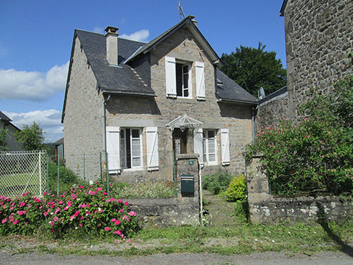 A house and partly converted stone built barn near Bugeat in the Limousin region of France