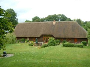 Barn Conversion With Thatched Roof In Hampshire