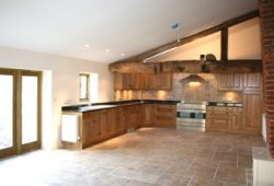 Four / five bedroom Grade II listed barn conversion set in about half an acre near Exeter, Devon