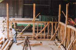 An oak and elm barn frame, repaired, dismantled and labelled and located near Bures in Suffolk
