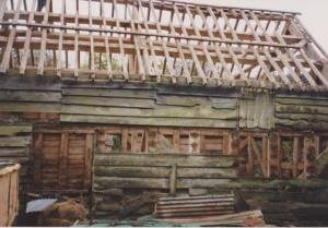 Oak barn frame without land dismantled and ready to be removed from present site